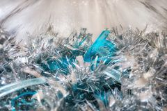 Magic vintage holiday glitter background with blinking Christmas lights. Silver and blue Christmas decorations in selective focus on a Christmas bokeh fairy Stock Image