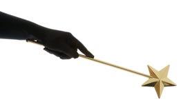Magic wand. Hand holding golden magic wand on white stock photography