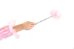 Magic wand. Detail of girl´s arm and hand with magic wand Stock Image