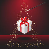 Magic wand with christmas present Stock Images