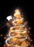 Magic wand and glittering Christmas tree Stock Photo