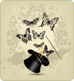 Magic wand and hat with butterflies on a vintage b Stock Photo