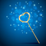 Magic wand with heart on blue background Stock Image
