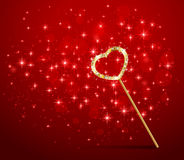 Magic wand with heart on red background Stock Photo