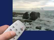 Magic Weather Control in hand. Buttons Sun, Cloudy, Storm, etc., storm on sea at background Stock Photos