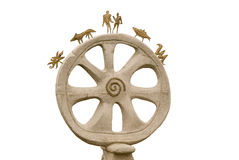 Magic wheel. The stone wheel and ornament on a white background Stock Image