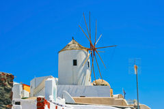 Magic windmill in Oia, Santorini Stock Photos