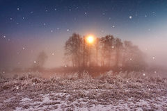 Magic winter Christmas night. Snowfall scene on a river Royalty Free Stock Images