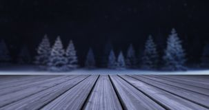 Magic winter forest with wooden deck front at evening stock images