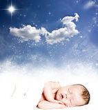 Magic winter night sky and sleeping baby. Magic winter night sky background and sleeping baby Stock Photo