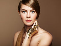 Magic woman portrait in gold Stock Photos