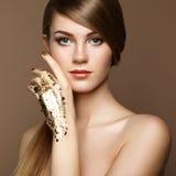 Magic woman portrait in gold stock image