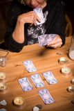 Magic woman using tarot cards Stock Image