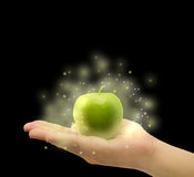 Magical apple on the palm in  background Stock Images
