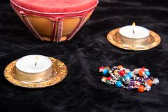 Magical attributes closeup. Magical attributes with candles on black background Stock Images