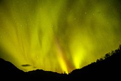 Magical Aurora borealis on Alaskan night sky. Aurora borealis on Alaska night sky, magical sky element, winter tourism, northern light tourism royalty free stock photo