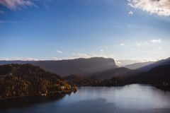 Lake Bled, island in the lake at sunrise in autumn or winter stock image
