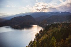 Lake Bled, island in the lake at sunrise in autumn or winter stock images