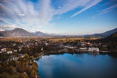 Lake Bled, island in the lake at sunrise in autumn or winter royalty free stock images