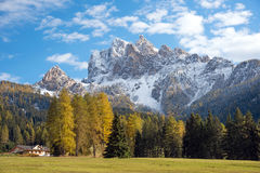 Magical autumn landscape with yellow larch on a background of mo. Untains in the Dolomites. The Italian Alps. Meditation, anti-stress, relaxation - concept Stock Photos