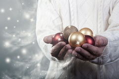 Magical baubles in hands. Christmas and new year concept Stock Image