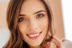 Close up look on beaming young woman Royalty Free Stock Photo