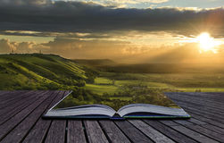 Magical book contents spilling into landscape stock photography