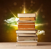 Magical books with ray of magical lights and colorful clouds Royalty Free Stock Image