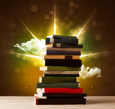 Magical books with ray of magical lights and colorful clouds vector illustration