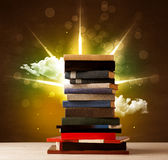 Magical books with ray of magical lights and colorful clouds Stock Image