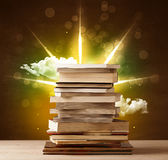 Magical books with ray of magical lights and colorful clouds Stock Images