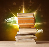 Magical books with ray of magical lights and colorful clouds Royalty Free Stock Images