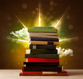 Magical books with ray of magical lights and colorful clouds Stock Photo
