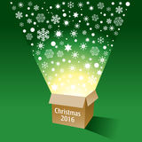 A magical cardboard box with radiant snowflakes. Flying out Royalty Free Stock Photo