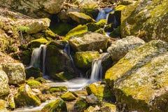 A Magical Cascading Waterfalls. A Spring view of a magical cascading waterfalls located on the Blue Ridge Parkway stock photos