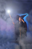 Magical Child in Wizard Costume. Young child in a wizard costume casting a spell Royalty Free Stock Image