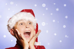 Magical Christmas. Excited boy amongst the snowflakes.   Let it snow, let it snow, let it snow Stock Images
