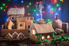 Magical Christmas gingerbread cottage and Christmas lights. On wooden table Stock Images