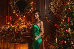 Lady in evening green dress stock images