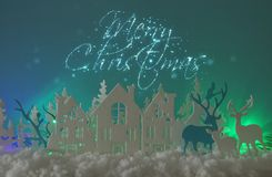 Magical Christmas paper cut winter background landscape with houses, trees, deer and snow in front of northern lights background. Magical Christmas paper cut royalty free stock images
