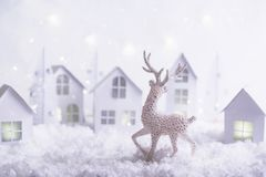 Magical Christmas paper village . Winter background landscape with houses, trees, deer on frosty blue background. royalty free stock photography