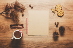 Magical christmas theme background, pine cones, coffee, cookies and an empty letter to santa Royalty Free Stock Photography