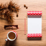 Magical christmas theme background, pine cones, coffee, cookies and an empty letter to santa Royalty Free Stock Image