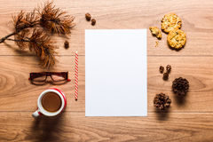 Magical christmas theme background, pine cones, coffee, cookies and an empty letter to santa. On wooden table Stock Photos