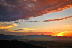 Magical clouds and sunset over mountain stock photo