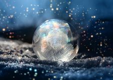 Magical color glitter frostball winter snow. Magical color glitter frostball on cold winter snow, crystal formations, dark background royalty free stock images