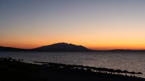 Magical Colors on the Horizon Moments Before Sun Goes Up. Sunris. E in Nea Vrasna, Greece Stock Photo
