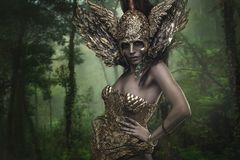 Magical, Deity, beautiful woman with green hair in golden goddes. S armor. Fantasy warrior Stock Image