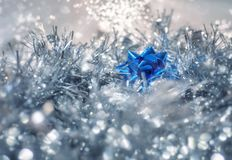 Magical fairy background for Christmas. Silver and blue Christmas decorations on an abstract bokeh fairy lights blurred background. Christmas and New Year Stock Photography