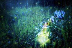 Magical fairy dust potion in bottle in the forest. Magical fairy dust potion in bottle in the forest stock images